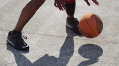 One on one street basketball; dribbling feet and shadow Stock Footage
