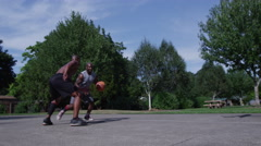 One on one street basketball; player makes layup Stock Footage