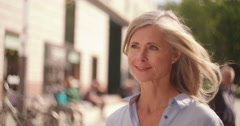 Mature woman walking confidently on a city street - stock footage