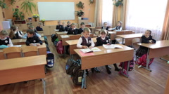 First class schoolchildren are ready for start of lesson. Wait for a teacher Stock Footage