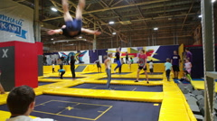 Trampolines are in the jumping club with having fun children Stock Footage
