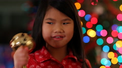 Young girl shaking Christmas bell Stock Footage