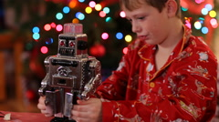 Boy playing with toy robot on Christmas Stock Footage
