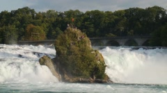 Rhine falls or Rheinfall - island rock in middle of torrent - stock footage