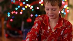 Boy opening Christmas gift and get surprise - stock footage