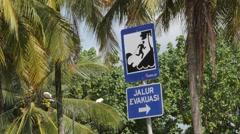 Tsunami evacuation sign at beach,Pangandaran,Java,Indonesia Stock Footage