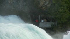 Rhine falls or Rheinfall - tourists in protected viewpoint by torrent - stock footage