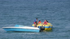Boys on inflatable water sled in sea,Pangandaran,Java,Indonesia Stock Footage