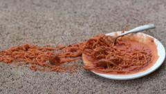 Plate of spaghetti spilling on carpet in slow motion; shot on Phantom Flex 4K at - stock footage