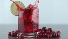 Ice splashing into cranberry juice in slow motion; shot on Phantom Flex 4K at Stock Footage