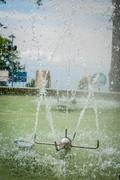 Sprinkler in water fountain at a park, Manizales, Colombia - stock photo