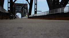 Pedestrians on Big Four Bridge, low angle. Stock Footage