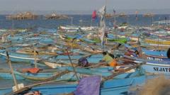 Boat leaving through harbour,Pangandaran,Java,Indonesia Stock Footage