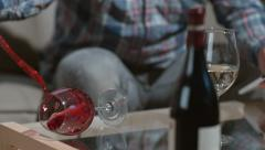 Man knocks over wine glass in slow motion; shot on Phantom Flex 4K at 1000 fps Stock Footage