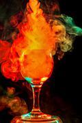 Orange smoke in a glass. Halloween. - stock photo