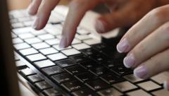 Office lady typing on dark laptop keyboard keys slow tilt 4K 2160p UltraHD fo Stock Footage