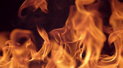 Closeup of fire burning on black background in slow motion; shot on Phantom Flex Stock Footage
