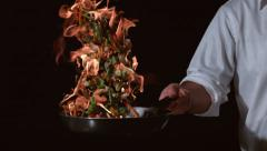 Slow motion shot of chef with flaming stir fry; shot on Phantom Flex 4K at 1000 Stock Footage