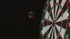 Dart hits bullseye in slow motion; shot on Phantom Flex 4K at 1000 fps - stock footage