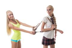 Sport or study. Beautiful blondes posing at camera - stock photo