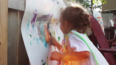 Young toddler paints picture, close up. Stock Footage