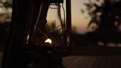 Storm Lantern Being Carried in Dusk - Slow Motion Stock Footage