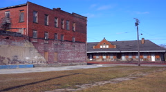 An old abandoned train station reminds us of a lost era of travel. Stock Footage