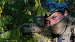 Portrait of the military. Playing airsoft Stock Footage