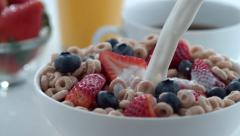 Milk pouring into bowl of cereal and berries; shot on Phantom Flex 4K at 1000 Stock Footage