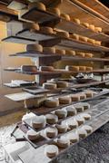Alpine hut that produces  homemade cheeses. - stock photo