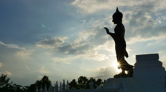 Time lapse of silhouette standing Buddha Stock Footage