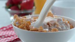 Milk pouring into cereal bowl in slow motion; shot on Phantom Flex 4K at 1000 Stock Footage