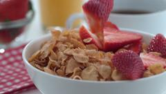 Strawberries falling into cereal in slow motion; shot on Phantom Flex 4K at 1000 - stock footage