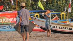 Boys flying kite on beach at sunset,Pangandaran,Java,Indonesia Stock Footage