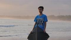 Boy holding kite on beach at sunset,Pangandaran,Java,Indonesia Stock Footage