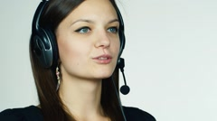 Female call center operator on white background Stock Footage