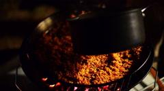 Preparing paella, adding water. - stock footage