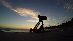 4K Beach acroyoga at sunset. Stock Footage