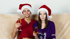 Young couple in Santa hat with champagne to celebrate New Year Stock Footage