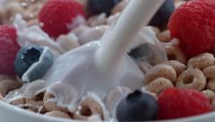 Closeup of milk pouring into bowl of cereal and berries; shot on Phantom Flex 4K Stock Footage
