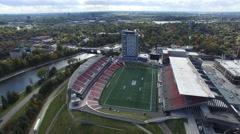 4k aerial football stadium smooth rotating angle Stock Footage