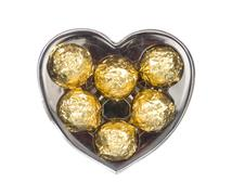 Gold chocolate in heart shape box isolated on white Stock Photos