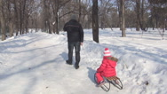 Stock Video Footage of POV Man Sledging Child, Kid on a Sleigh in Park, Little Girl Sledding in Winter