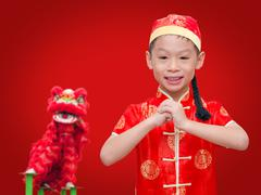 Asian boy with gesture of congratulation - stock photo