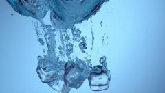 Ice splashing into water in slow motion; shot on Phantom Flex 4K at 1000 fps Stock Footage