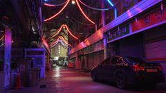 Empty Nighttime Alleyway With Color Changing Lights Seoul South Korea Stock Footage