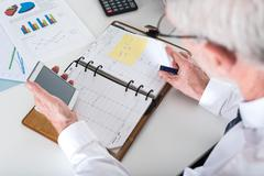 Stock Photo of Businessman taking an appointment