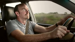 Driver reacts with shock as he sees danger in the road ahead. Stock Footage