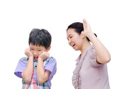 Mother Being Physically Abusive Towards Son - stock photo