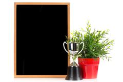 Stock Photo of Wood blackboard and Champion cup